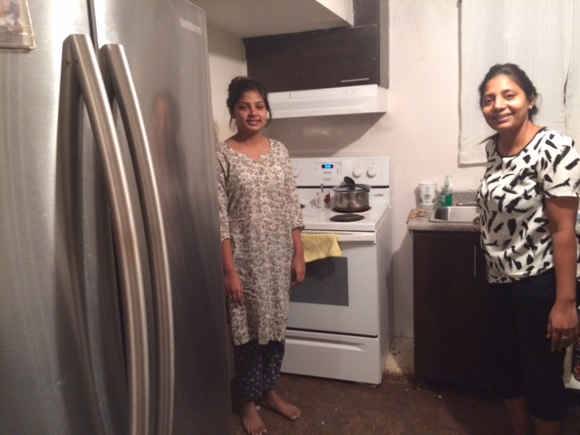 Farhat and Aanya in kitchen