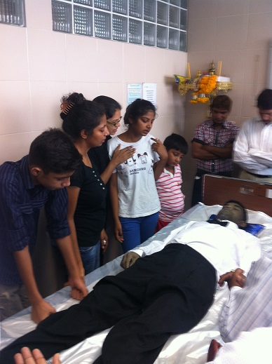 family standing beside dead body